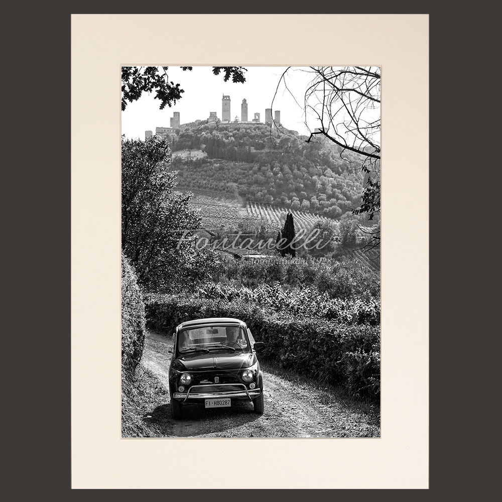 The countryside around San Gimignano Tuscany with Fiat 500