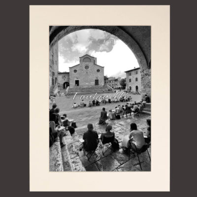 Photos of painters under the loggia in Piazza Duomo San Gimignano Tuscany