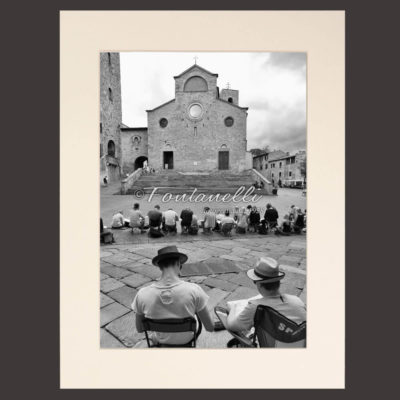 Black and white photo painters in Piazza Duomo San Gimignano Tuscany